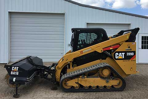 Track skid loader with 84inch angle broom